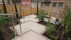 series of garden terraces with gravelled surface and steel ballustrade