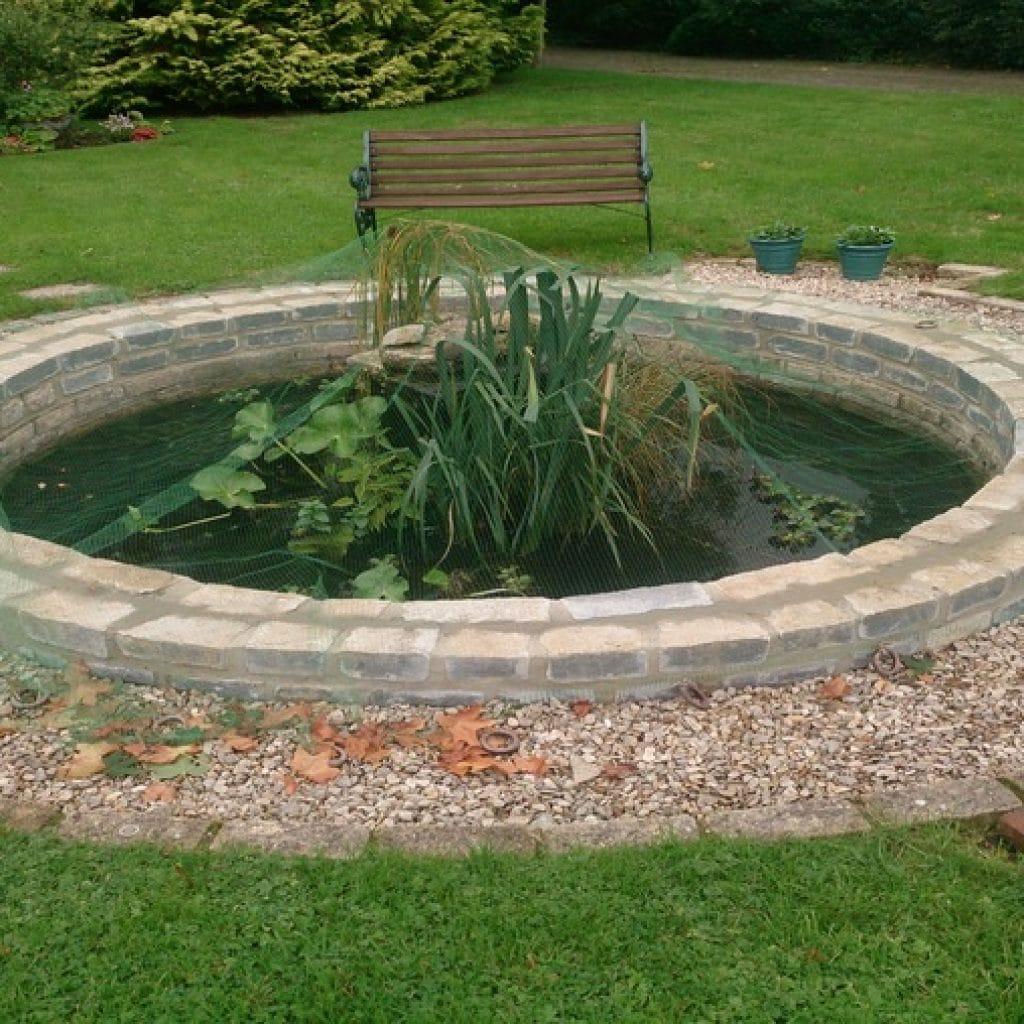 water in garden design a circular pond