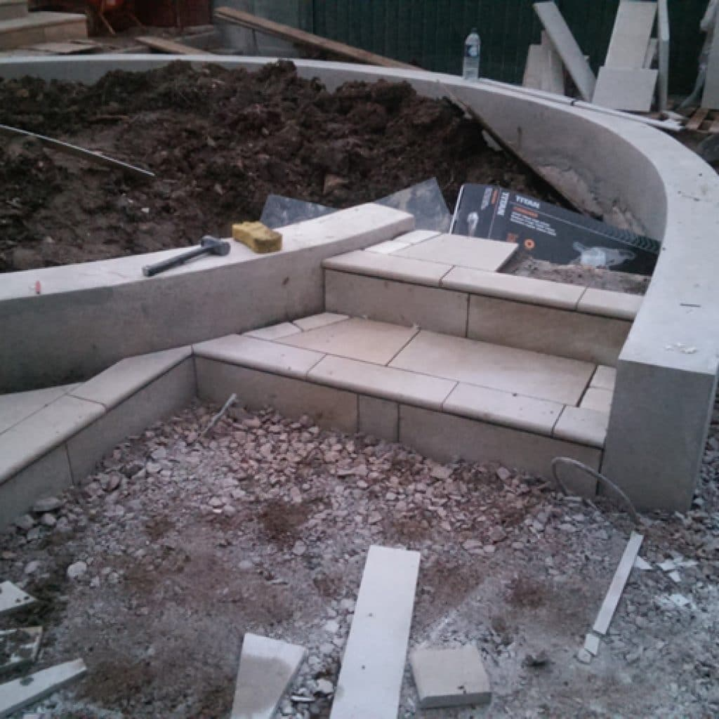 landscaping a back garden with steps, paving and retaining walls