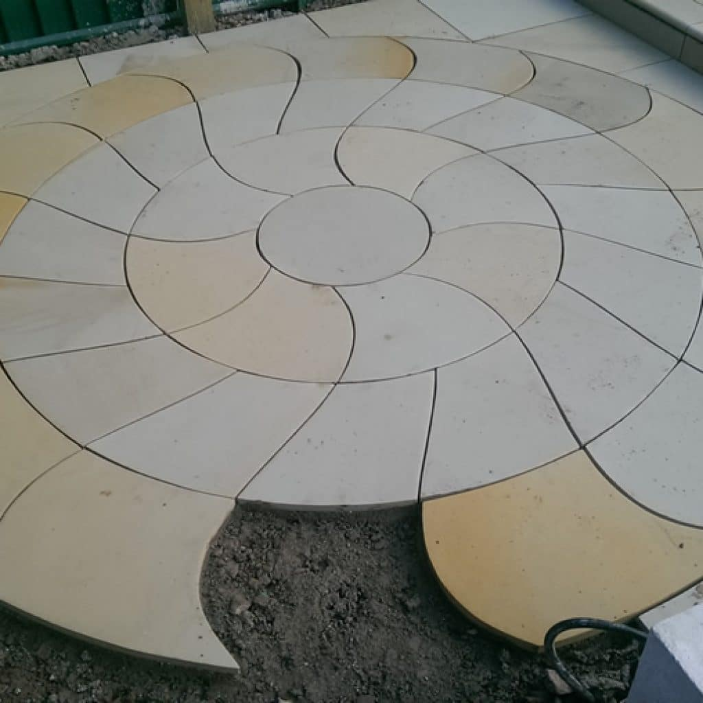 stone circle with intricately shaped pavers
