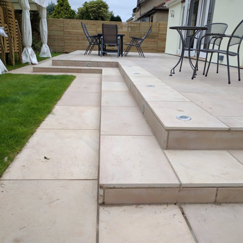recessed patio lights in large, stepped sandstone patio