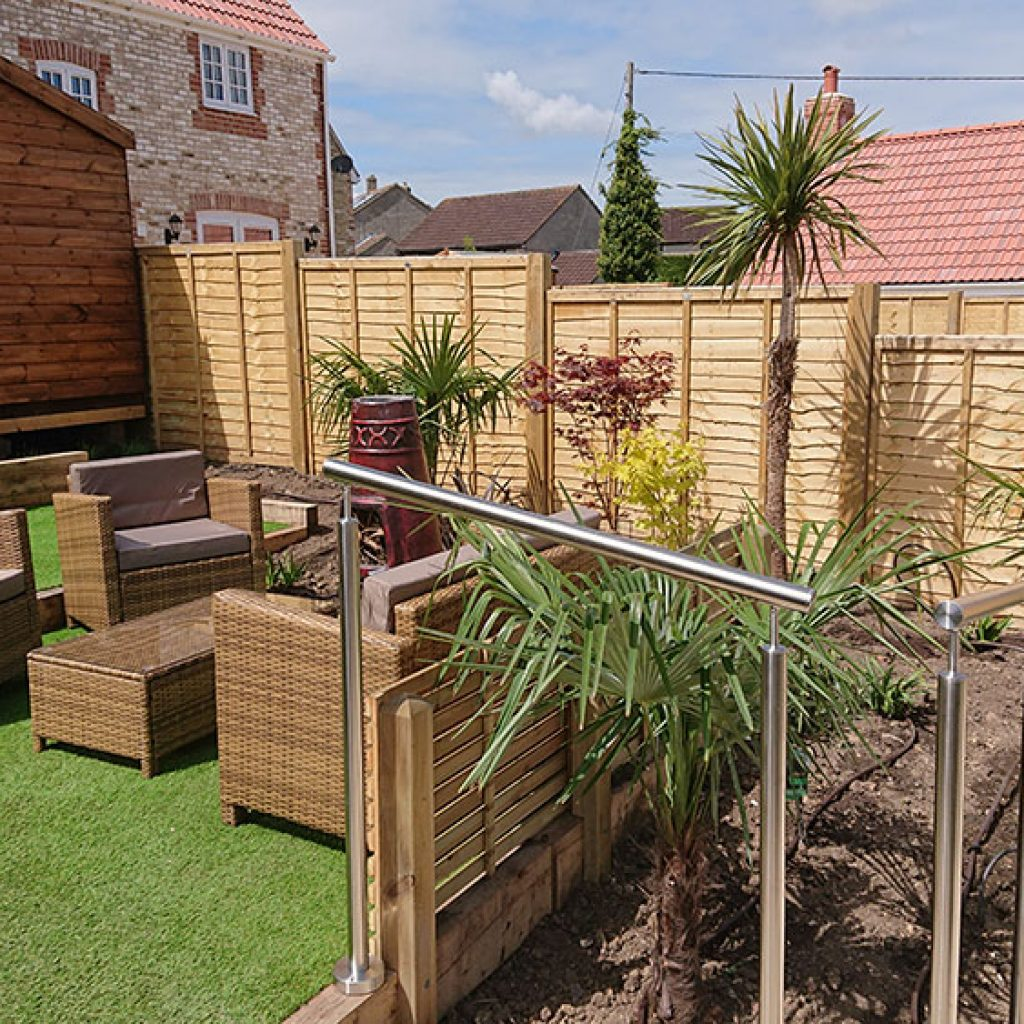low maintenance garden with artificial grass lawn