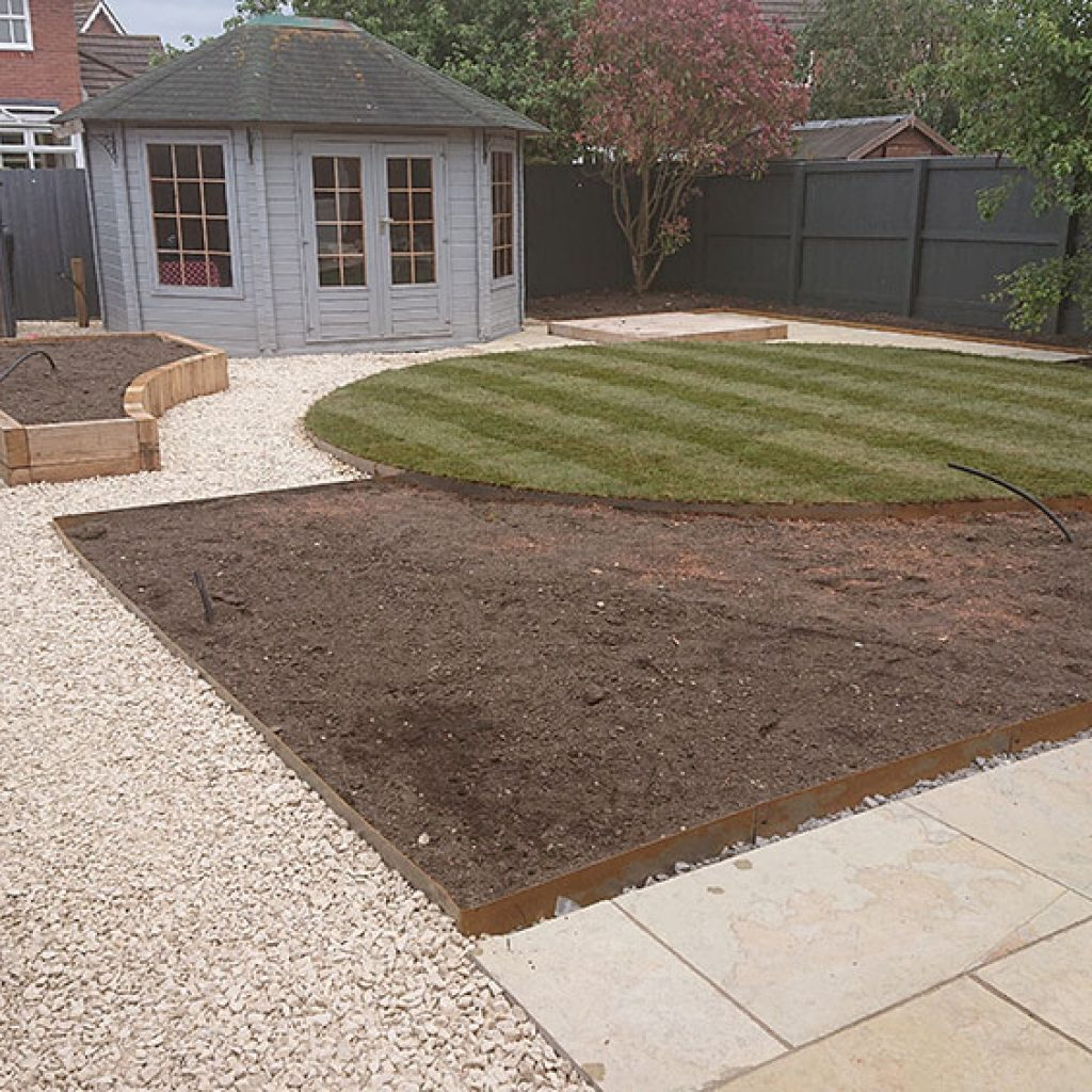 newly turfed circular lawn with stripes