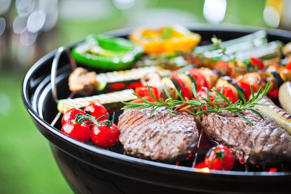 cooking meat and vegetables on barbecue