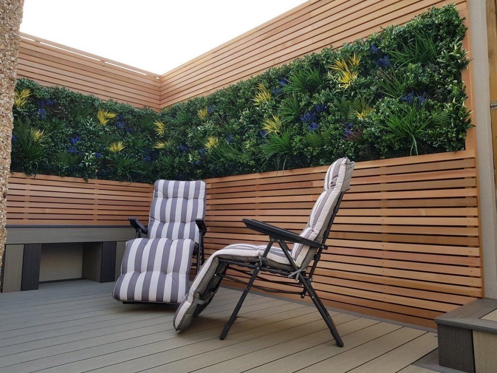 small garden design with artifical green walls