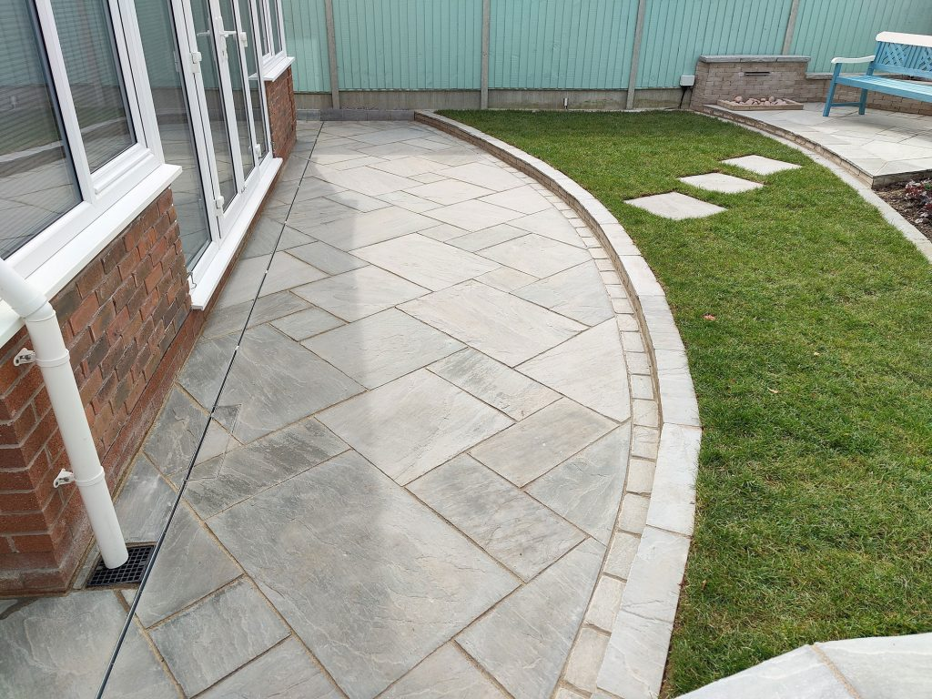 small curved patio in natural limestone