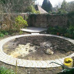 circular lawn prepared for turfing