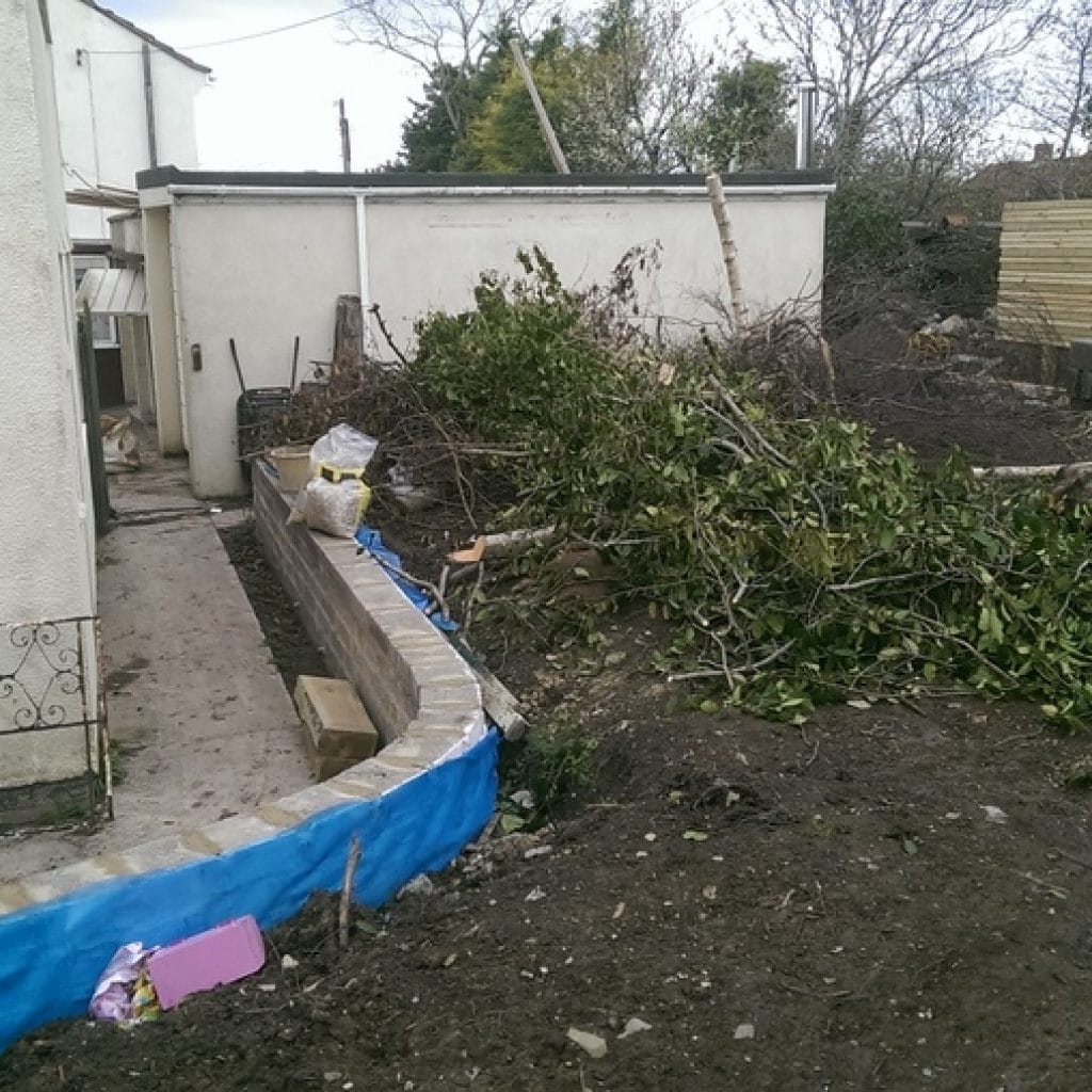 garden clearance removing unwanted plants, structures and debris