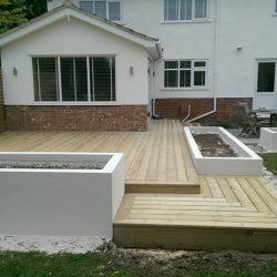 decking design with inbuilt planters
