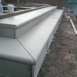 bullnose steps being installed into a landscaping project