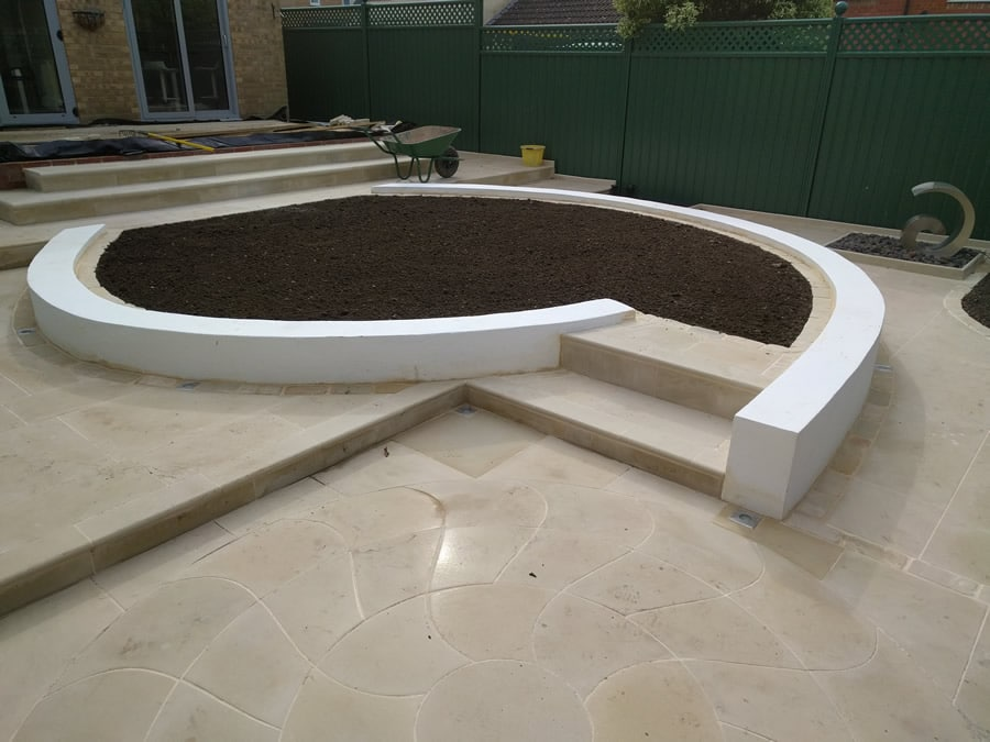 A modern garden design with geometric lines and neutral colours
