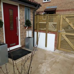 back door with secure fence and neat, easy to clean pavers