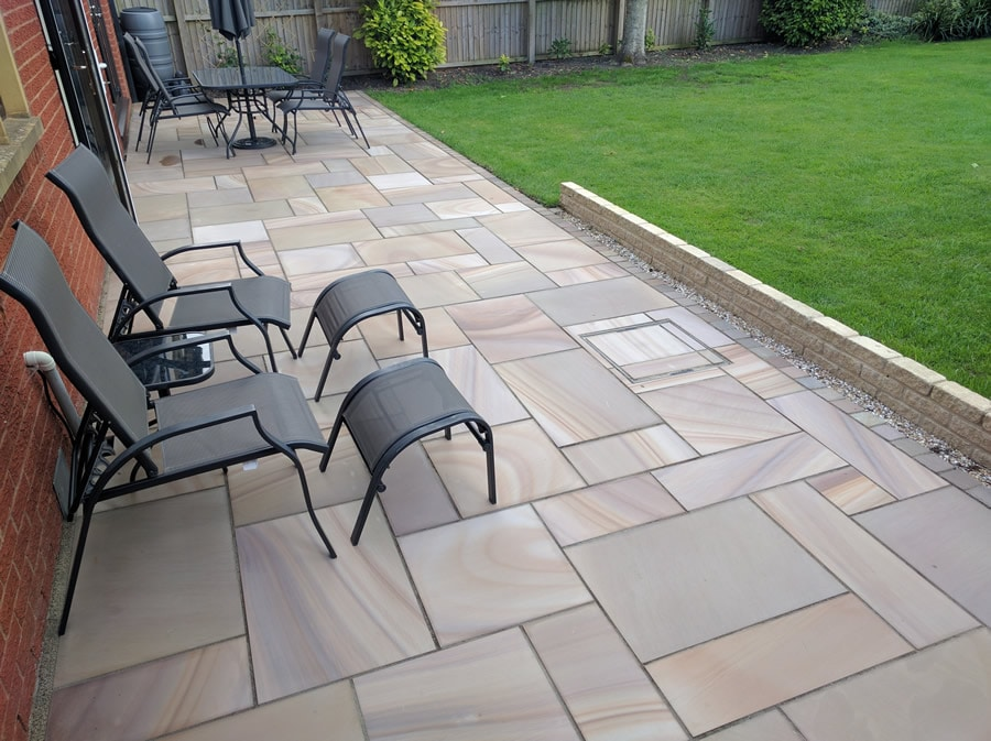 sawn rainbow sandstone laid to create a patio