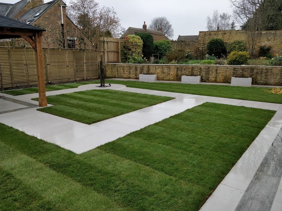 natural lawn with porcelain paved paths