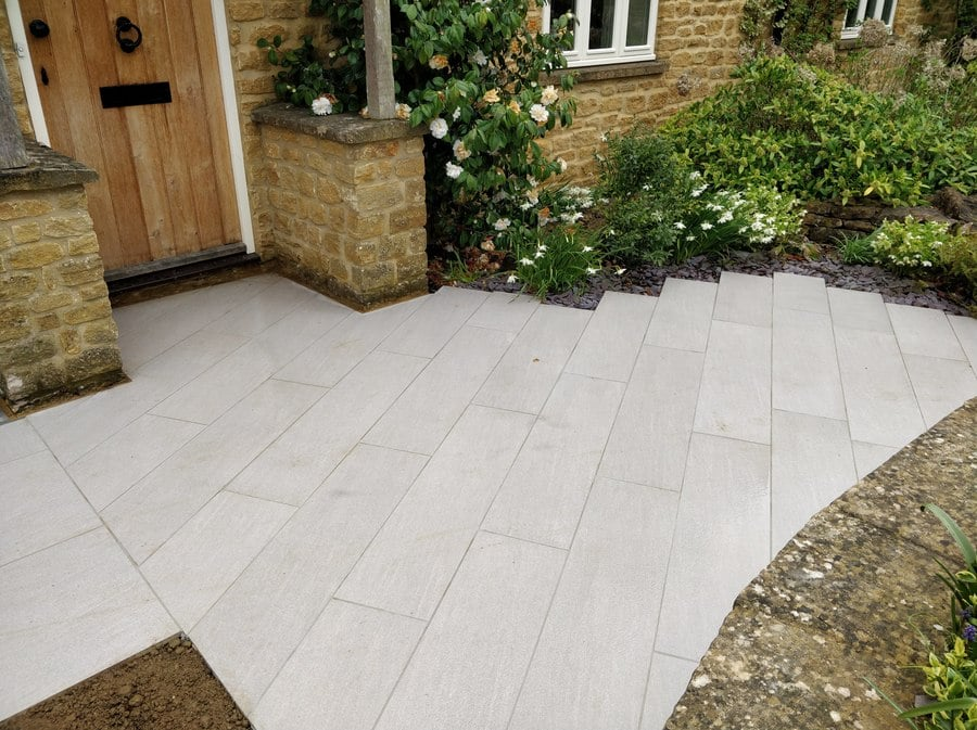 attractive paved entrance to country style property