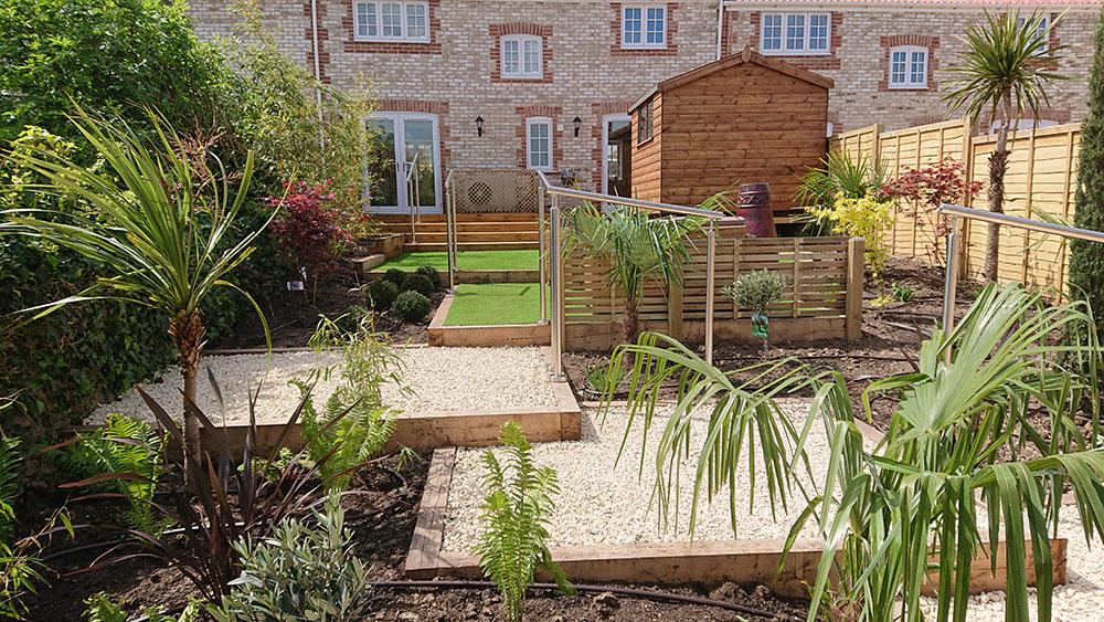 artificial grass in low maintenance garden
