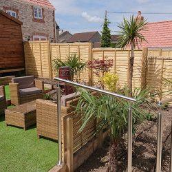 low maintenance garden with artificial grass lawn