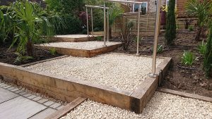 series of steps with timber risers and aggregate surface