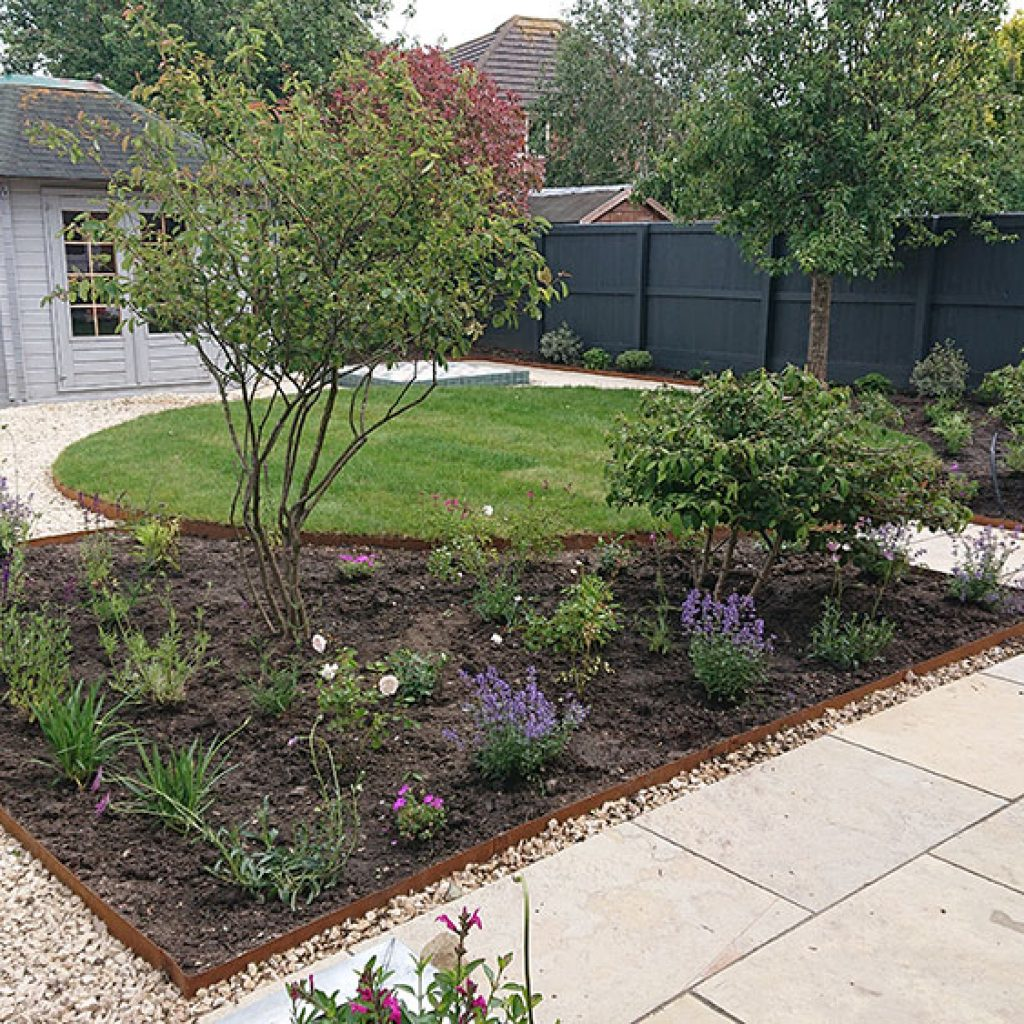 traditional garden design with circular lawn and bee friendly planting