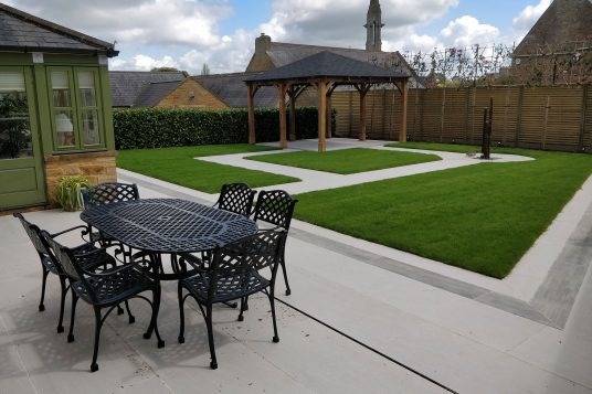 contemporary garden with porcelain paving and lawn