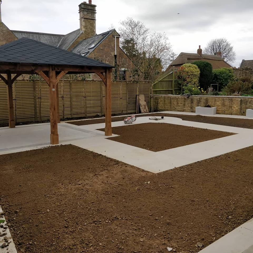 traditional timber garden building in part finished garden makeover