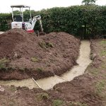 early stages of a landscaping project creating footings for a curved wall